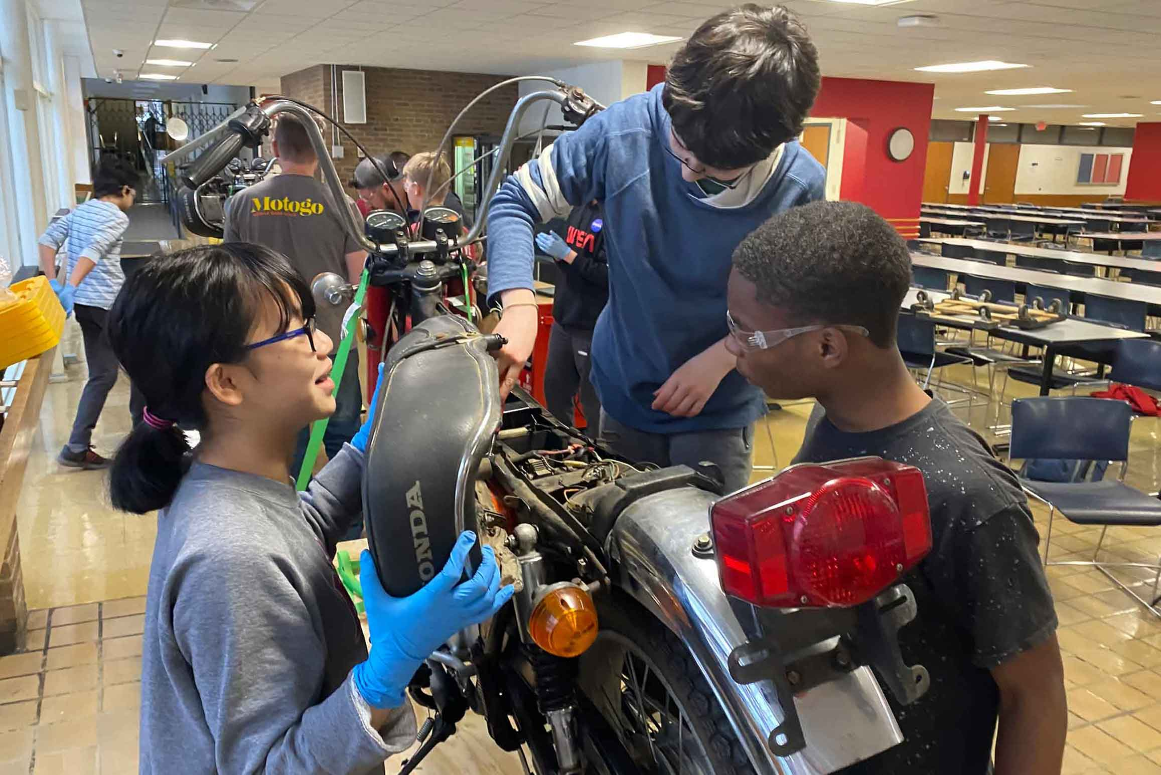 MS students fixing motorcycle